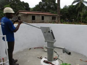 The Water Project:  Staff Collecting After Finished Installing Pump
