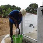 The Water Project: Lungi, Mahera, #5 MacAuley Street -  Staff Testing Cylinder