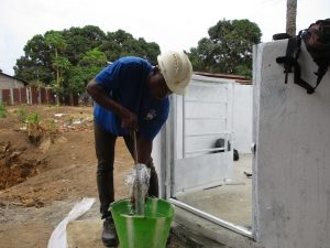 The Water Project:  Staff Testing Cylinder