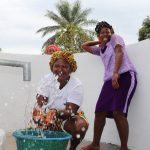 The Water Project: Lungi, Mahera, #5 MacAuley Street -  Woman Happy Drinking Clean And Safe Drinking Water