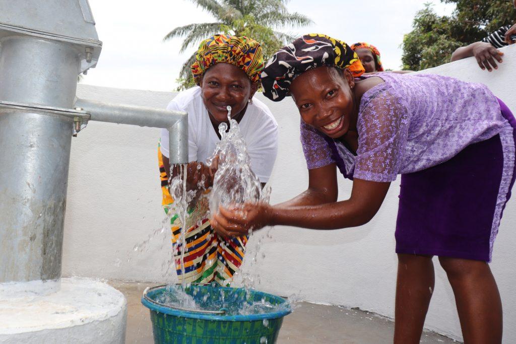 The Water Project : sierraleone20408-happy-women-splashing-water