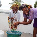 The Water Project: Lungi, Mahera, #5 MacAuley Street -  Women Happy Playing And Splashing Clean