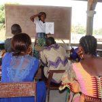 The Water Project: Lungi, Tardi, Khodeza Community School -  Hygiene Facilitator Teaching About Bathing