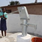 The Water Project: Lungi, Tardi, Khodeza Community School -  Student Pumping The Well