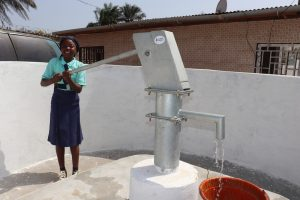 The Water Project:  Student Pumping The Well