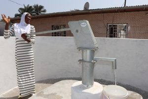 The Water Project:  Teacher Collecting Safe Drinking Water