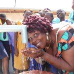 The Water Project: Lungi, Tardi, Khodeza Community School -  Councilor Victoria Kanu Happy Drinking Water