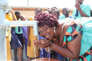 The Water Project:  Councilor Victoria Kanu Happy Drinking Water