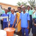 The Water Project: Lungi, Tardi, Khodeza Community School -  Students Looking At Clean Water Flowing