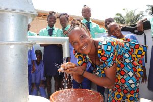 The Water Project:  Teacher Happy Drinking Water