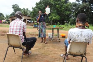 The Water Project:  Hygiene Facilitator Teaching About Tippy Taps