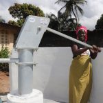 The Water Project: Lungi, Kambia, #6 Bangura St. -  Woman Collecting Clean And Safe Drinking Water