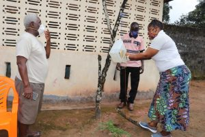 The Water Project:  Hygiene Facilitator Teaches Tippy Tap Use