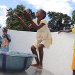 The Water Project: Lungi, Kambia, #6 Bangura St. -  Kids Celebrating And Splashing