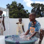 The Water Project: Lungi, Kambia, #6 Bangura St. -  Kid Celebrating And Splashing