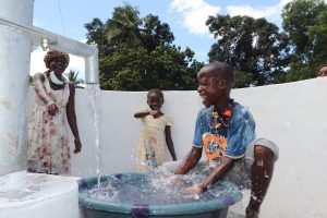 The Water Project:  Kid Celebrating And Splashing