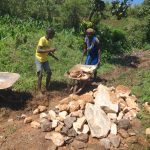 The Water Project: Mahira Community, Anunda Spring -  Community Members Deliver Stones