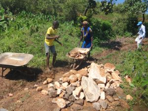 The Water Project:  Community Members Deliver Stones