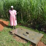 The Water Project: Indulusia Community, Yakobo Spring -  A Woman With A Sanplat