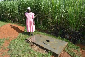 The Water Project:  A Woman With A Sanplat