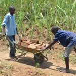 The Water Project: Shitavita Community, Patrick Burudi Spring -  Boys Bring Bricks To Spring Site