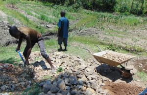 The Water Project:  Mixing Stones And Sand
