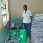 The Water Project: Ivakale Primary School & Community - Rain Tank 2 -  School Security Guard Ernest Ambani Inspects The Hardware Materials