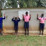 The Water Project: Kapkoi Primary School -  Boys Cebrate Next To Their Latrines