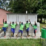The Water Project: Boyani Primary School -  Boys Pose With Their Latrines
