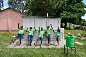 The Water Project:  Boys Pose With Their Latrines