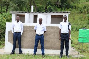 The Water Project:  Boys Pose In Front Of Their Latrines