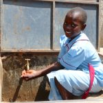 The Water Project: Mukoko Baptist Primary School -  A Student At The Water Point