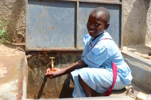 The Water Project:  A Student At The Water Point