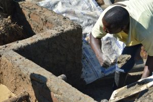 The Water Project:  Plastering Inner Walls