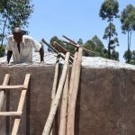 The Water Project: Friends Kisasi Secondary School -  Artisan Lowers Himself Into Tank