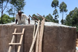 The Water Project:  Artisan Lowers Himself Into Tank