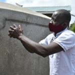 The Water Project: Ivakale Primary School & Community - Rain Tank 2 -  Erick Demonstrates Cleaning The Guaze