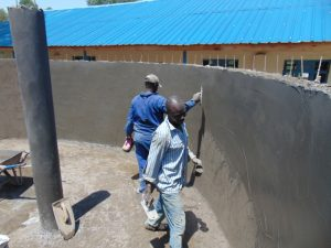 The Water Project:  Applying Final Plaster Coat