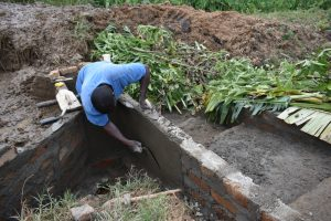 The Water Project:  Plastering Outer Walls