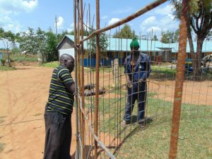 The Water Project:  Reinforcing The Wire Mesh With Rebar