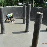 The Water Project: Isango Primary School -  Plastering The Tank Floor