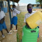 The Water Project: Ivakale Primary School & Community - Rain Tank 2 -  Oscar Shows How To Refill The Handwashing Station