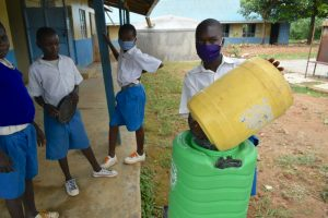The Water Project:  Oscar Shows How To Refill The Handwashing Station