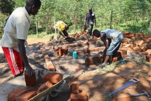 The Water Project:  Community Members Aid In Latrine Construction