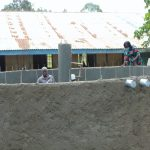 The Water Project: Ivakale Primary School & Community - Rain Tank 2 -  Catherine Chepkemoi Inspecting Tank Under Construction