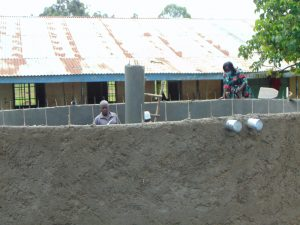 The Water Project:  Catherine Chepkemoi Inspecting Tank Under Construction