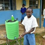 The Water Project: Ivakale Primary School & Community - Rain Tank 2 -  Student Demonstrates Handwashing