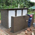 The Water Project: Friends Kisasi Secondary School -  Latrine Plaster