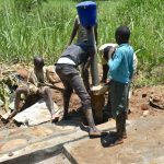 The Water Project: Shitavita Community, Patrick Burudi Spring -  Reinstalling Chlorine Dispenser
