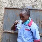 The Water Project: Mukoko Baptist Primary School -  Drinking Water From The Tank